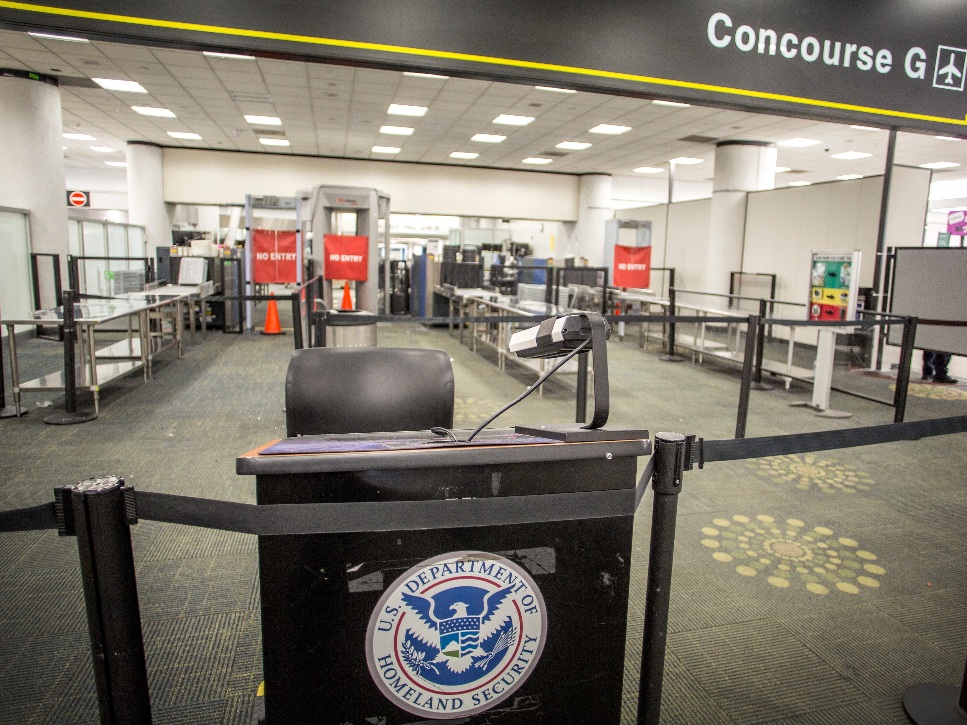 The entrance of the Miami International Airport's Terminal G remained closed due to the government shutdown, in Miami, Florida, USA, 12 January 2019. The current partial shutdown of the US federal government has become the longest in US history, on Jan. 12, 2019 surpassing the previous 21-day shutdown of 1995-1996. Over 800,000 federal employees are impacted by the shutdown, with around 400,000 furloughed and being paid later and the rest deemed 'essential', who must work without pay, though retroactive pay is expected, with January 11 marking the first missed paycheck.