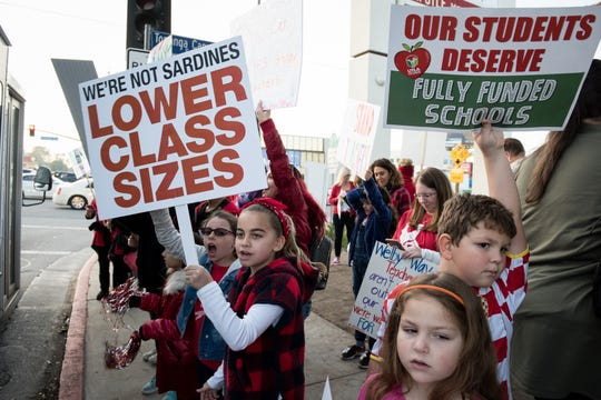 Students show support for teachers at a rally in Woodland Hills, Calif. Unless LAUSD and United Teachers Los Angeles, which represents 31,000 educators in Southern California, can come to an agreement on a contract, teachers across the district will strike on Monday.