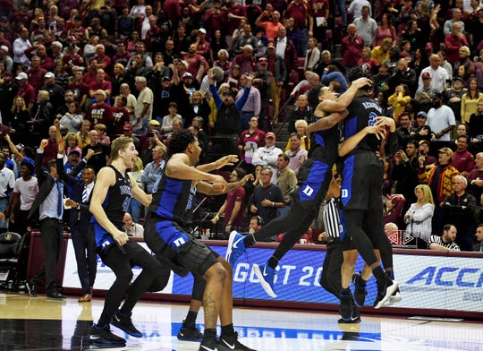 Duke Blue Devils players celebrate after winning the game against the Florida State Seminoles at Donald L. Tucker Center.