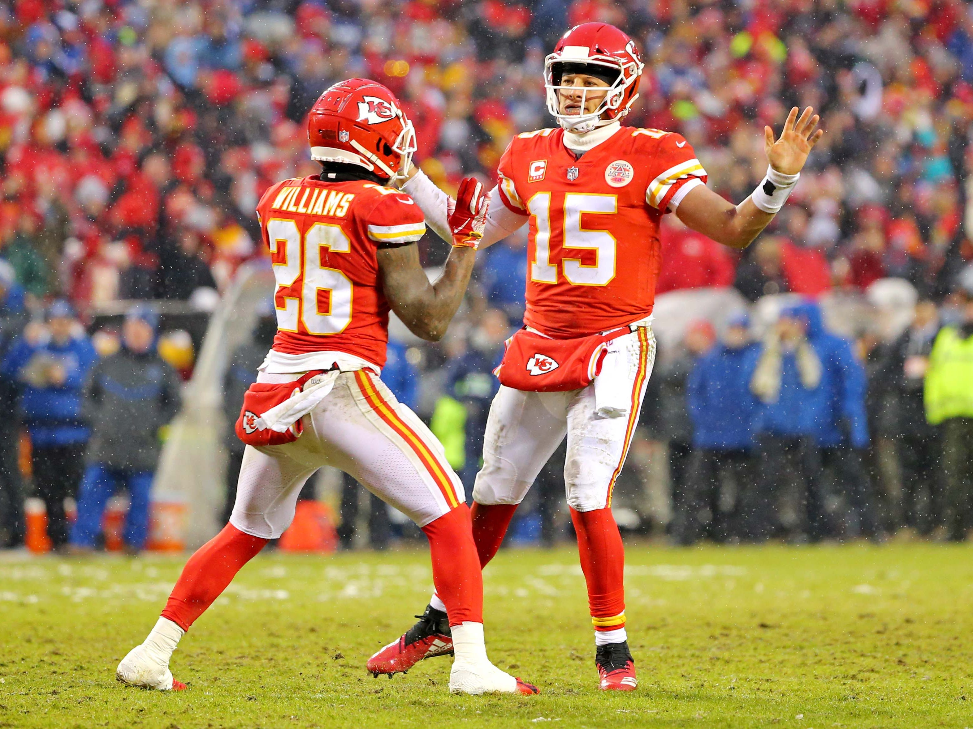 Kansas City Chiefs quarterback Patrick Mahomes (15) celebrates with Kansas City Chiefs running back Damien Williams (26) after scoring a touchdown  during the first quarter against the Indianapolis Colts in an AFC Divisional playoff football game at Arrowhead Stadium.