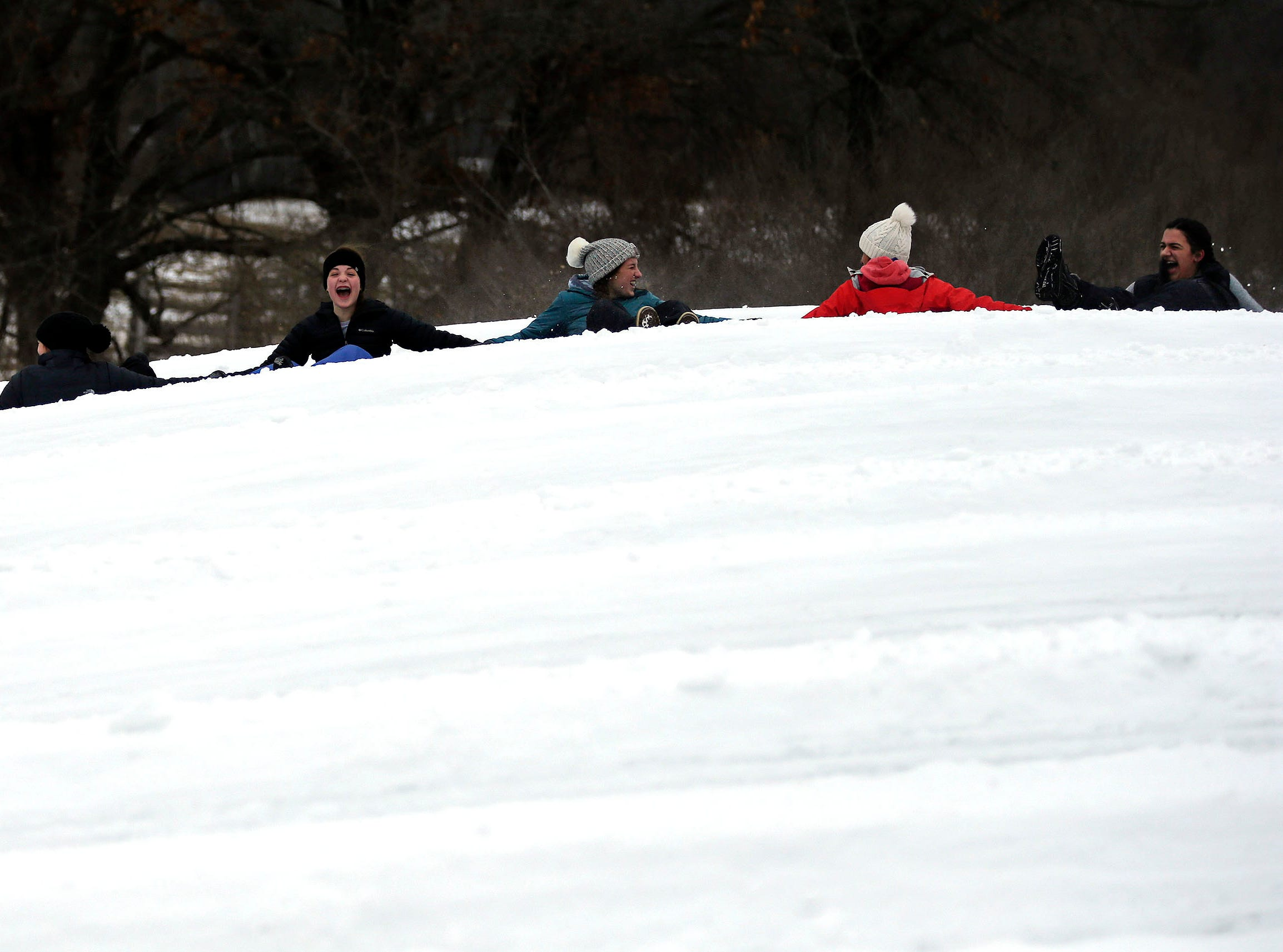 A party of 12 friends from Neenah celebrate a birthday as they go tubing at Nordic Mountain Sunday, January 13, 2019, near Wild Rose, Wis.