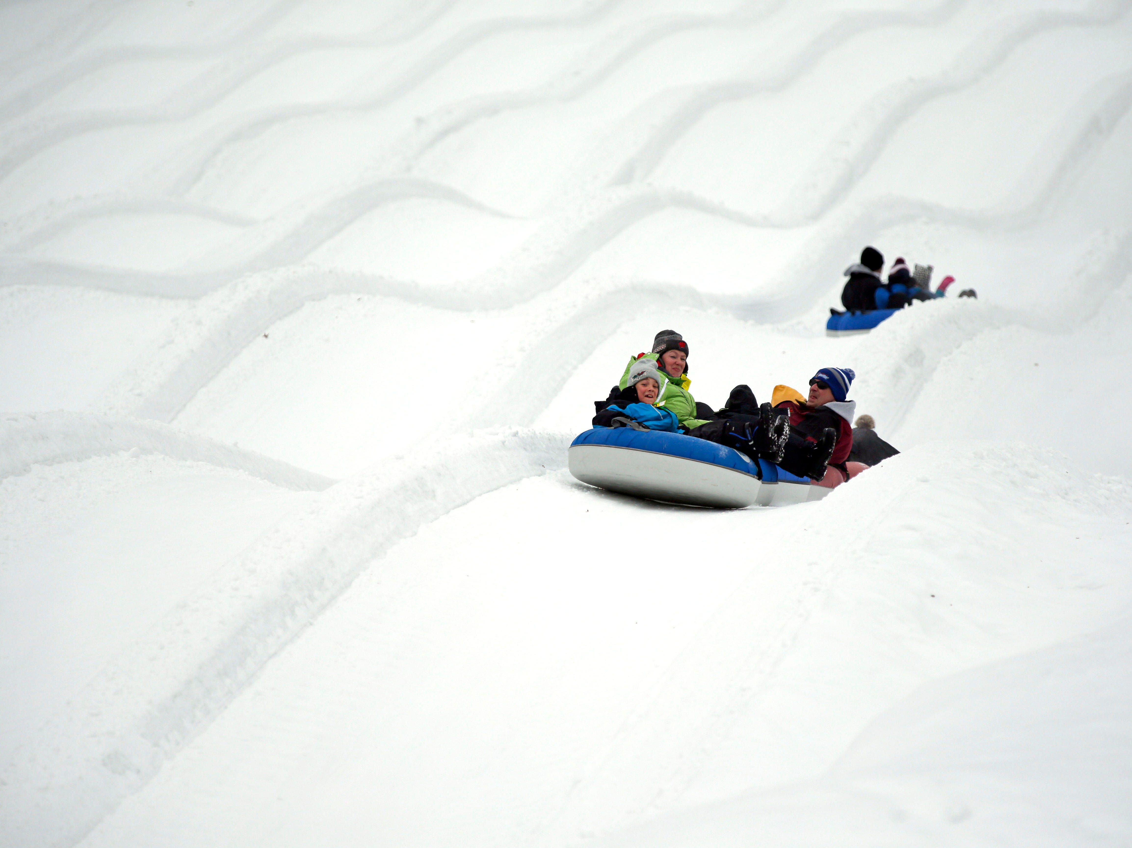 A mild winter day brings tubing fans to Nordic Mountain Sunday, January 13, 2019, near Wild Rose, Wis.