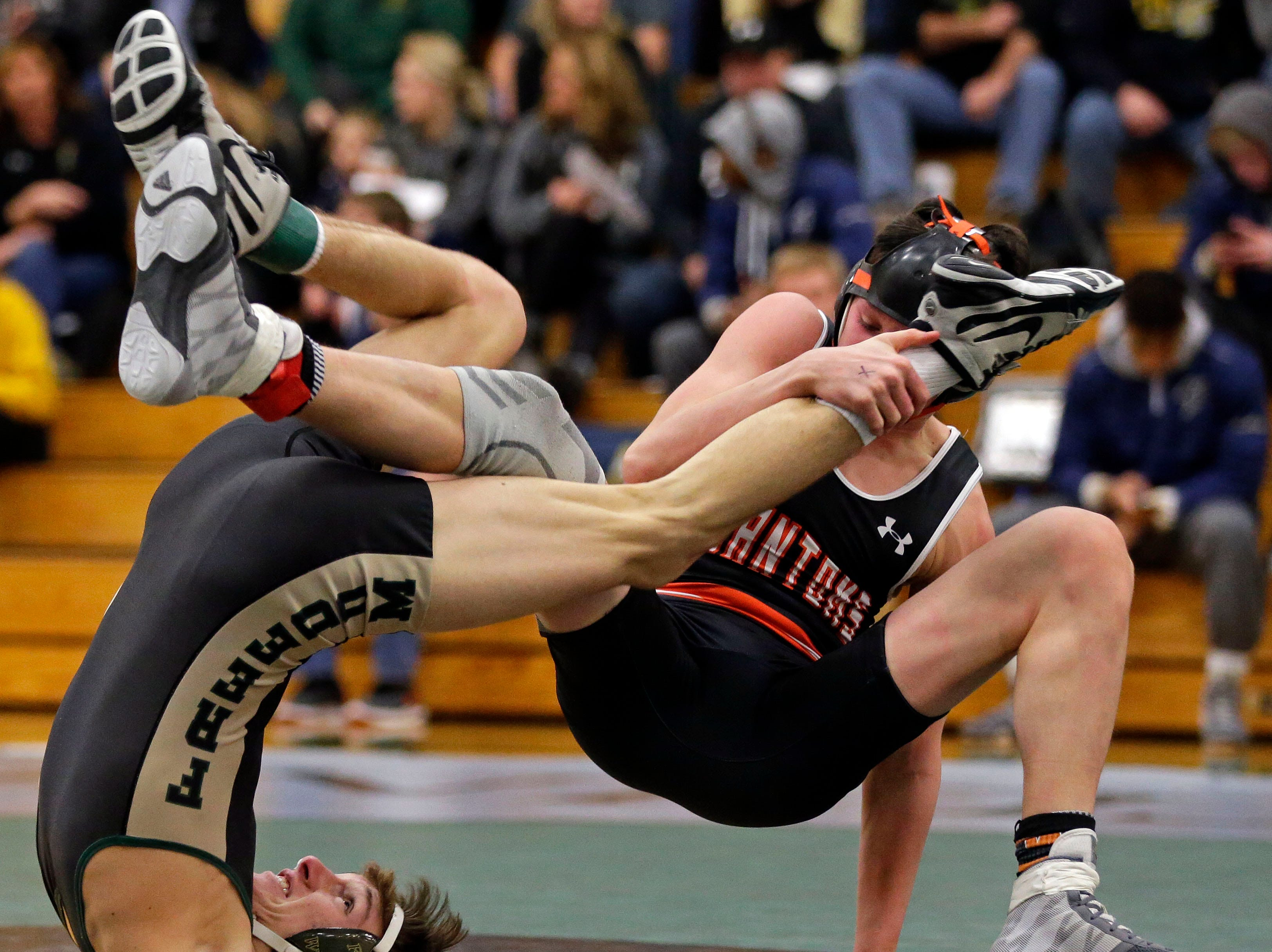 Colton Kater of Freedom wrestles Jake Hendricks of West De Pere in the 113 weight class during the 2019 Freedom Irish Invitational Saturday, January 12, 2019, at Freedom High School in Freedom, Wis.