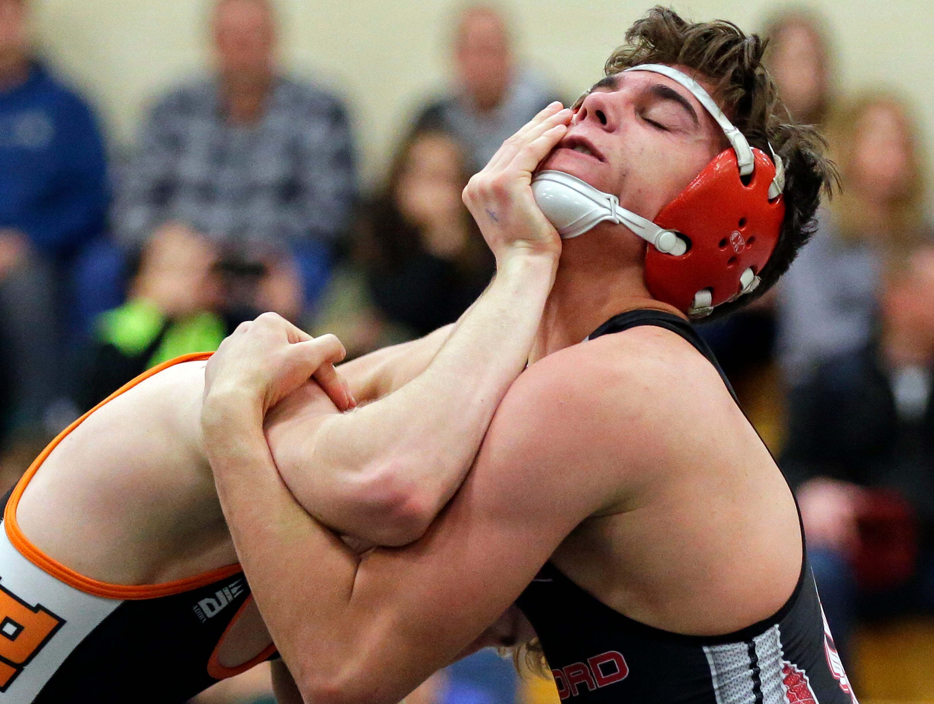 Dane Higgins of Medford wrestles Zach Weiler of Burlington during the 2019 Freedom Irish Invitational Saturday, January 12, 2019, at Freedom High School in Freedom, Wis.