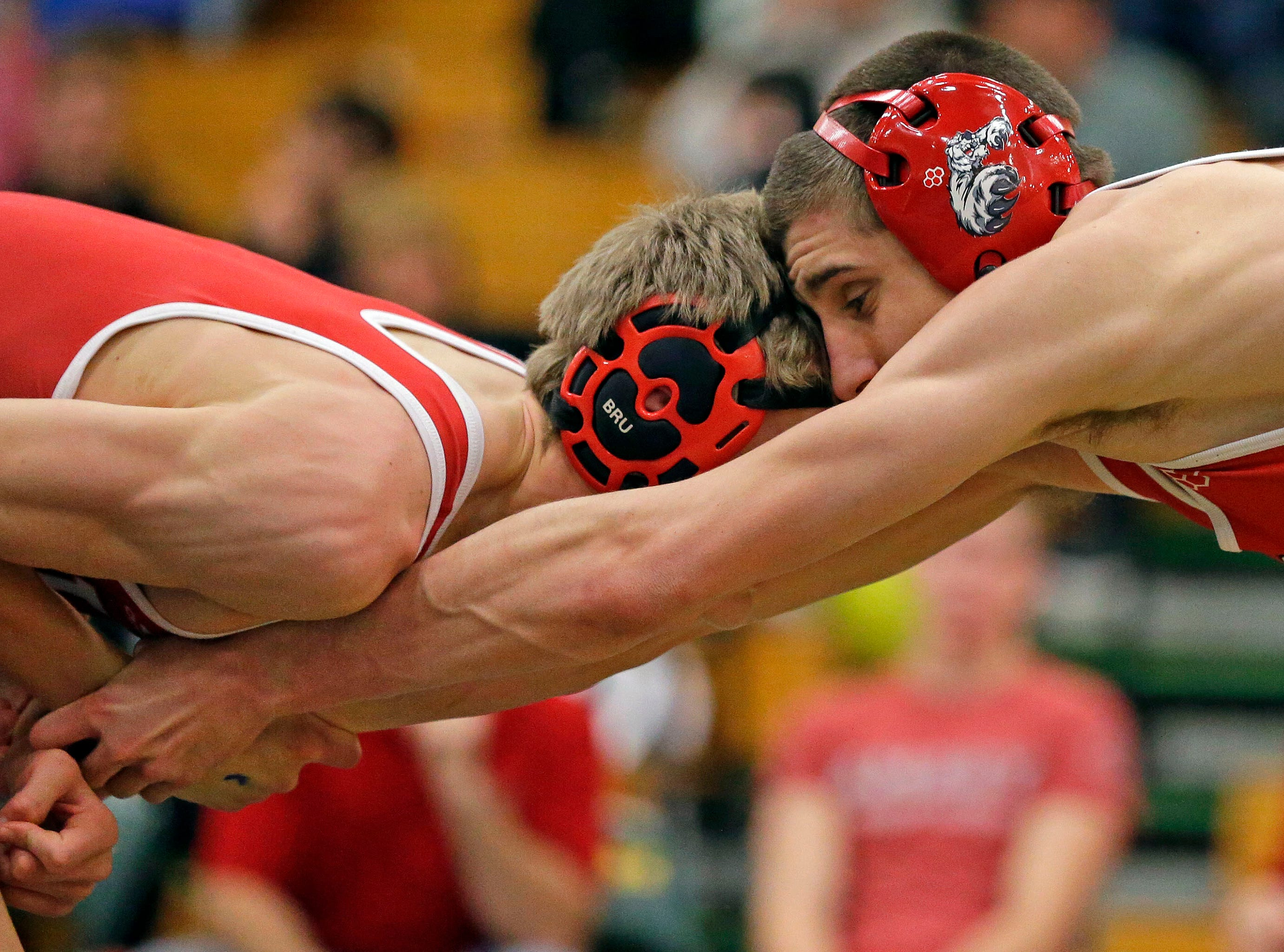 Keaton Tollakson of Amery, left, wrestles Jacob Collar of Hortonville during the 2019 Freedom Irish Invitational Saturday, January 12, 2019, at Freedom High School in Freedom, Wis.