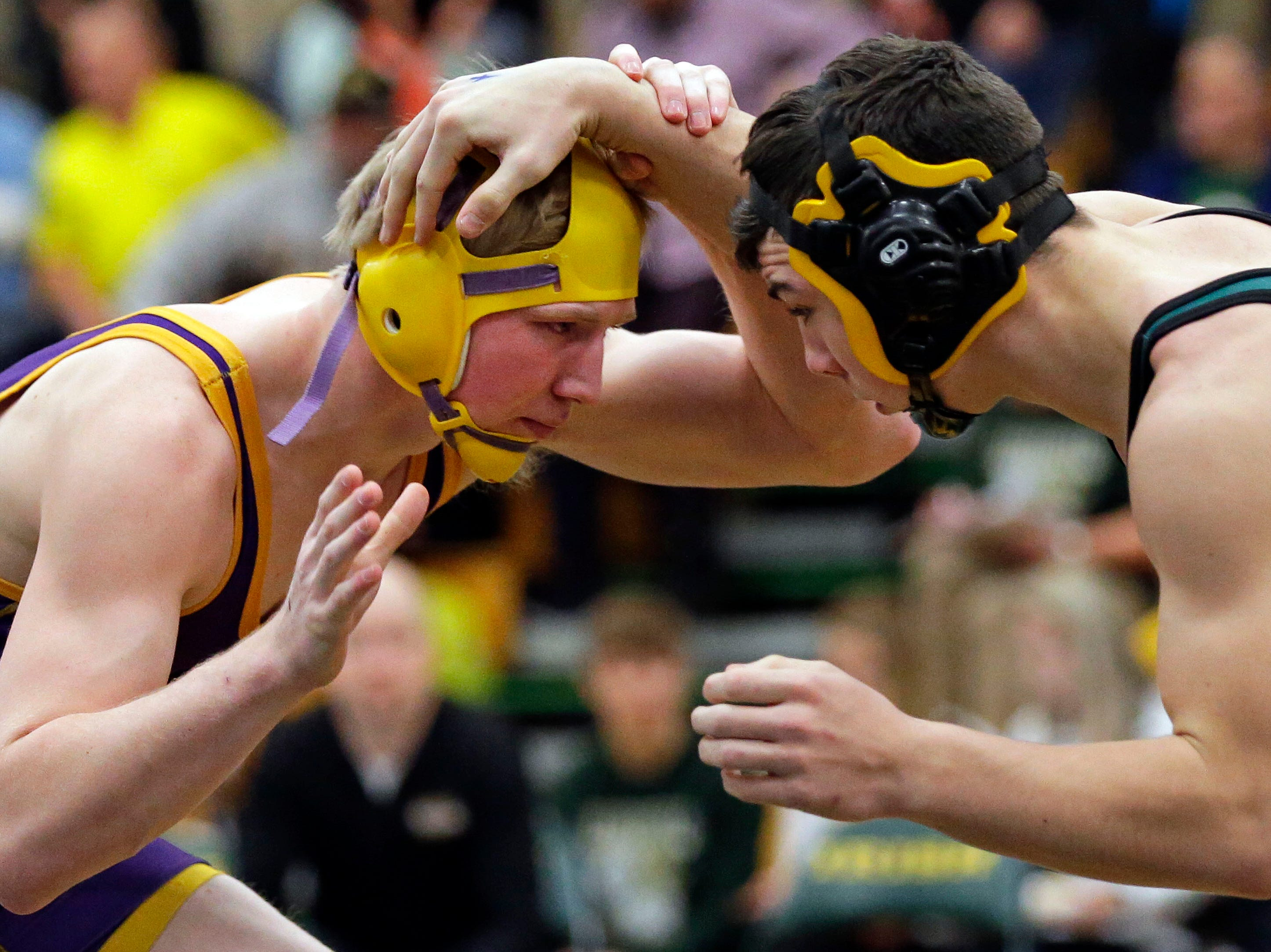 Alex Schmitz of Denmark, left, wrestles Connor Ramage of Ashwaubenon during the 2019 Freedom Irish Invitational Saturday, January 12, 2019, at Freedom High School in Freedom, Wis.