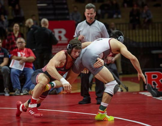 Rutgers' sixth-year senior Anthony Ashnault (left), shown wresting against Rider on Dec. 16, will have a tough bout against Oklahoma State's Kaden Gfeller Sunday afternoon at the Rutgers Athletic Center