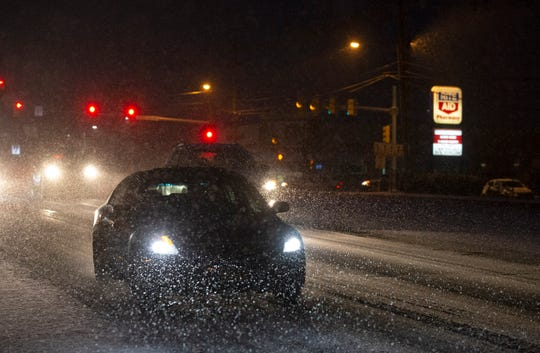 Car slowly move around in the slippery icy snow that is falling in southern Ocean County as the drive Bay Ave in Barnegat on Sunday January 13, 2019.