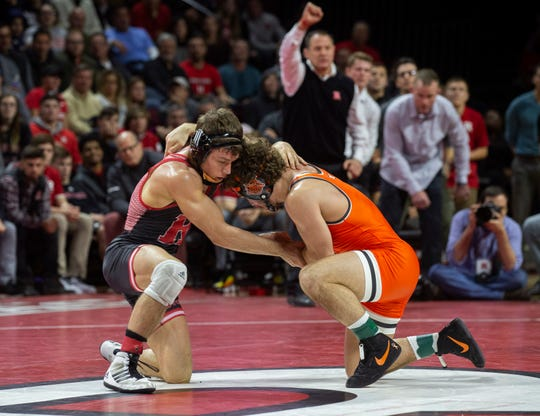 Rutgers' Nick Suriano (left) was defeated by Oklahoma State's Daton Fix 3-2 when he was penalized for a hands to the face in the second sudden victory period. This is from earlier in the bout with Rutgers' coach Scott Goodale (background) asking for a stalling call on Fix.