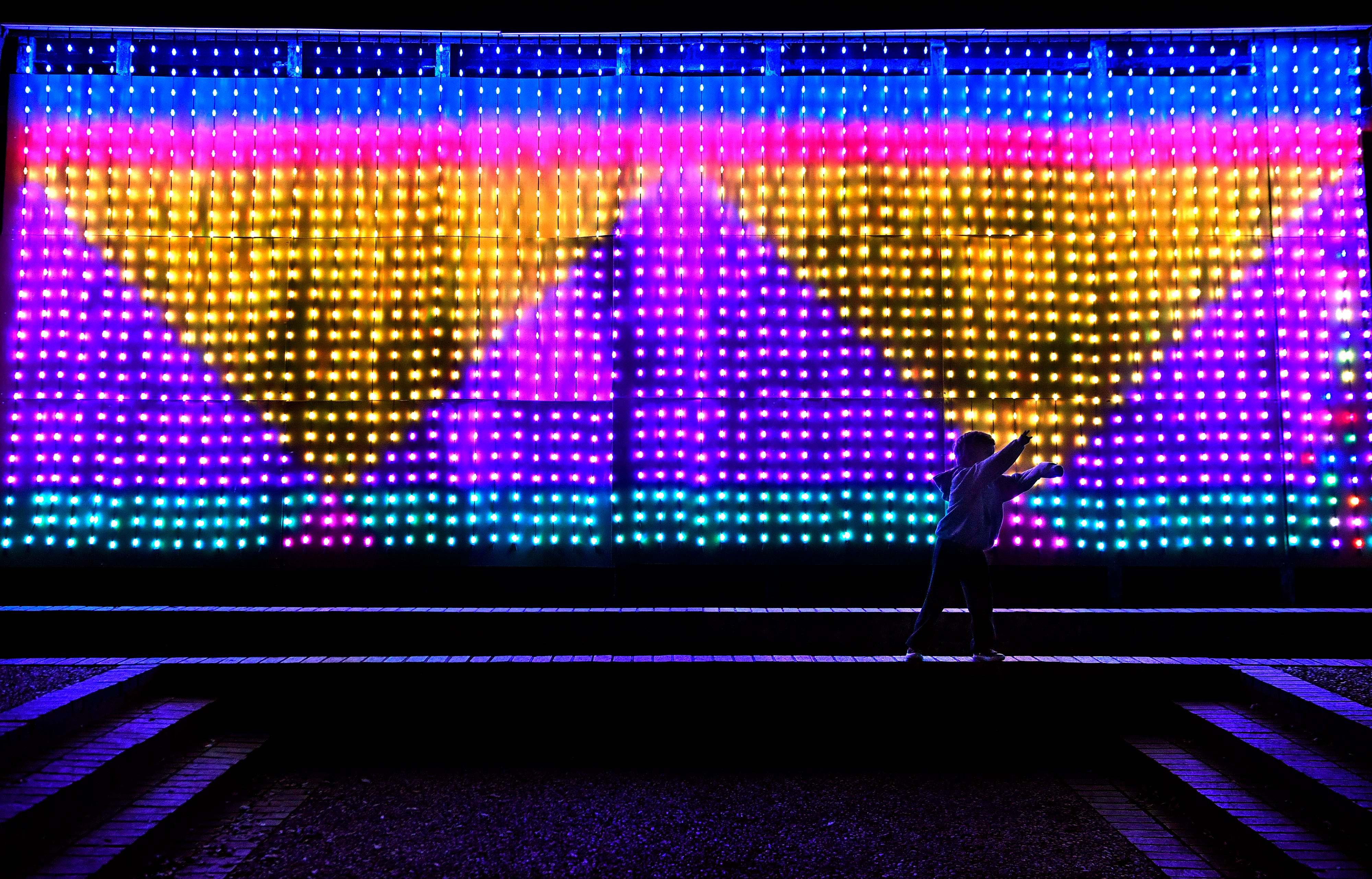 A child plays Thursday in front of the electric display in Minter Park.