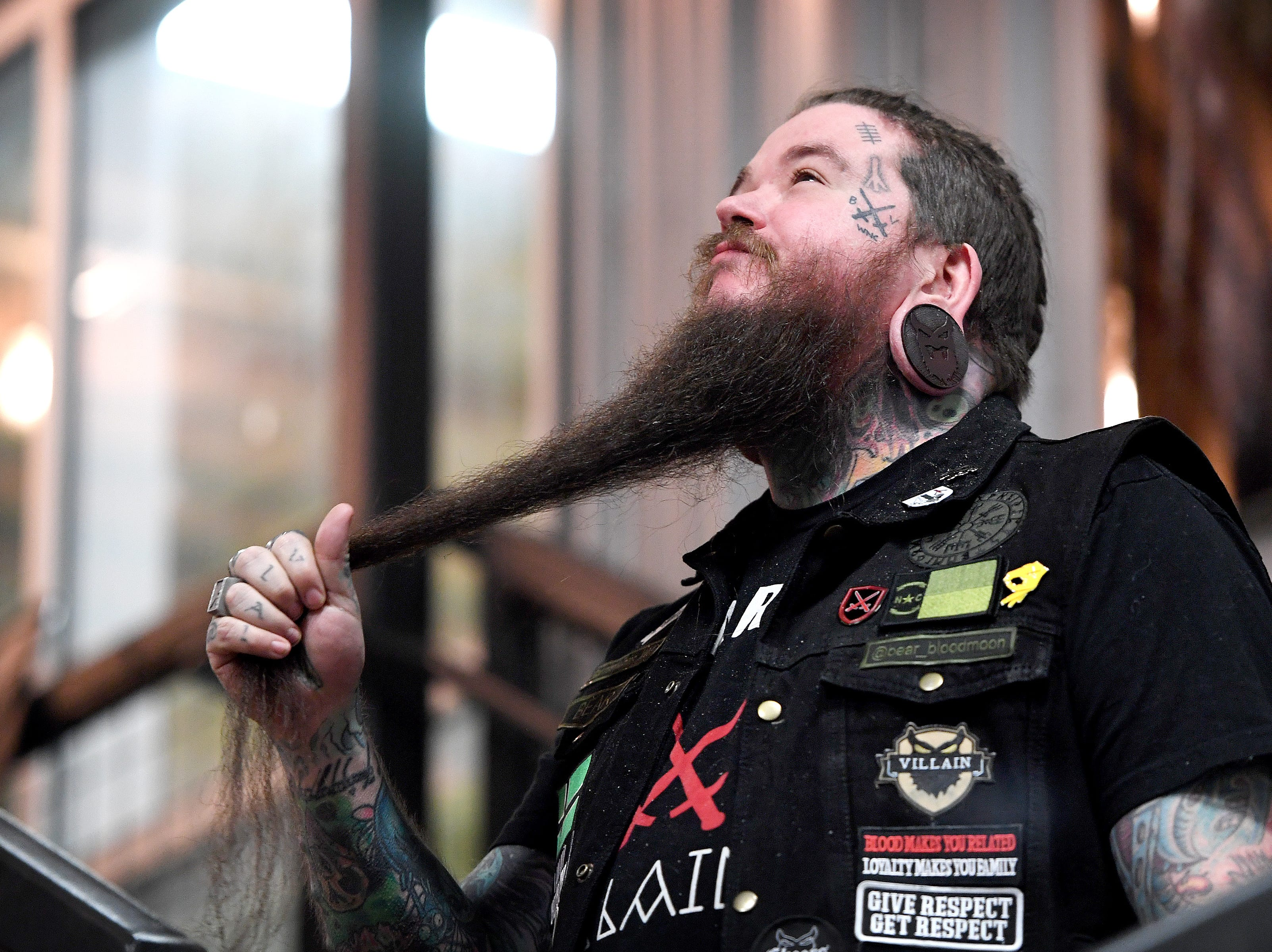 Bear Russell strokes his beard as he competes in the beard contest of Winter Beardfest at Bold Rock Hard Cider in Mills River on Jan. 12, 2019. Proceeds from the competition benefitted the Black Mountain Home Foster Care. Organizers are hoping to make the event annual.