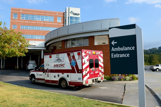 An ambulance pulls up to the emergency room entrance of Mission Hospital.