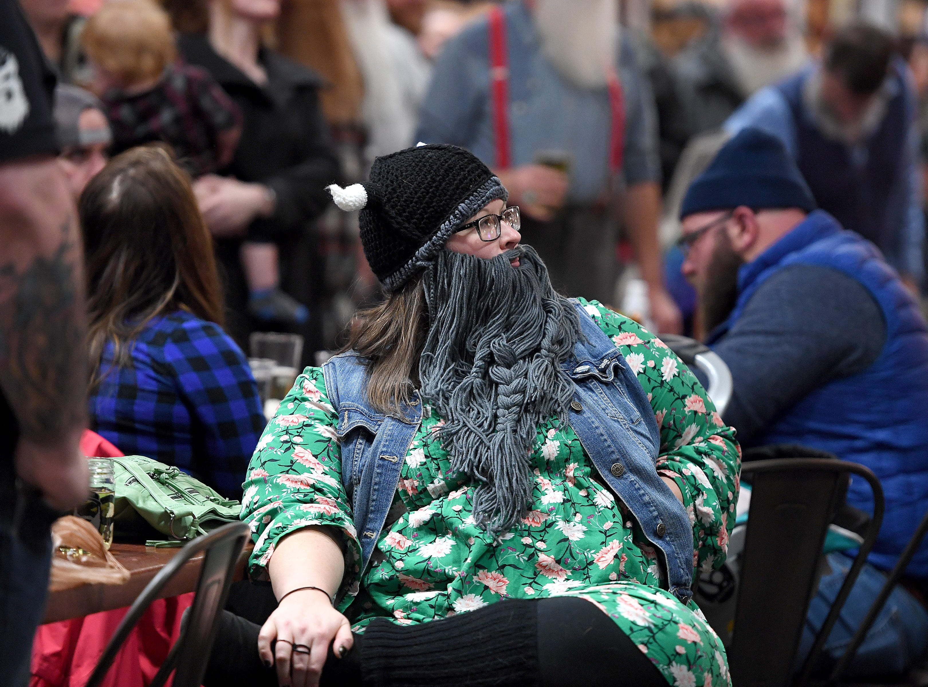 Alana Tucker watches the beard competition as she waits for her category, whiskerina, during Winter Beardfest at Bold Rock Hard Cider in Mills River on Jan. 12, 2019. Proceeds from the competition benefitted the Black Mountain Home Foster Care. Organizers are hoping to make the event annual.