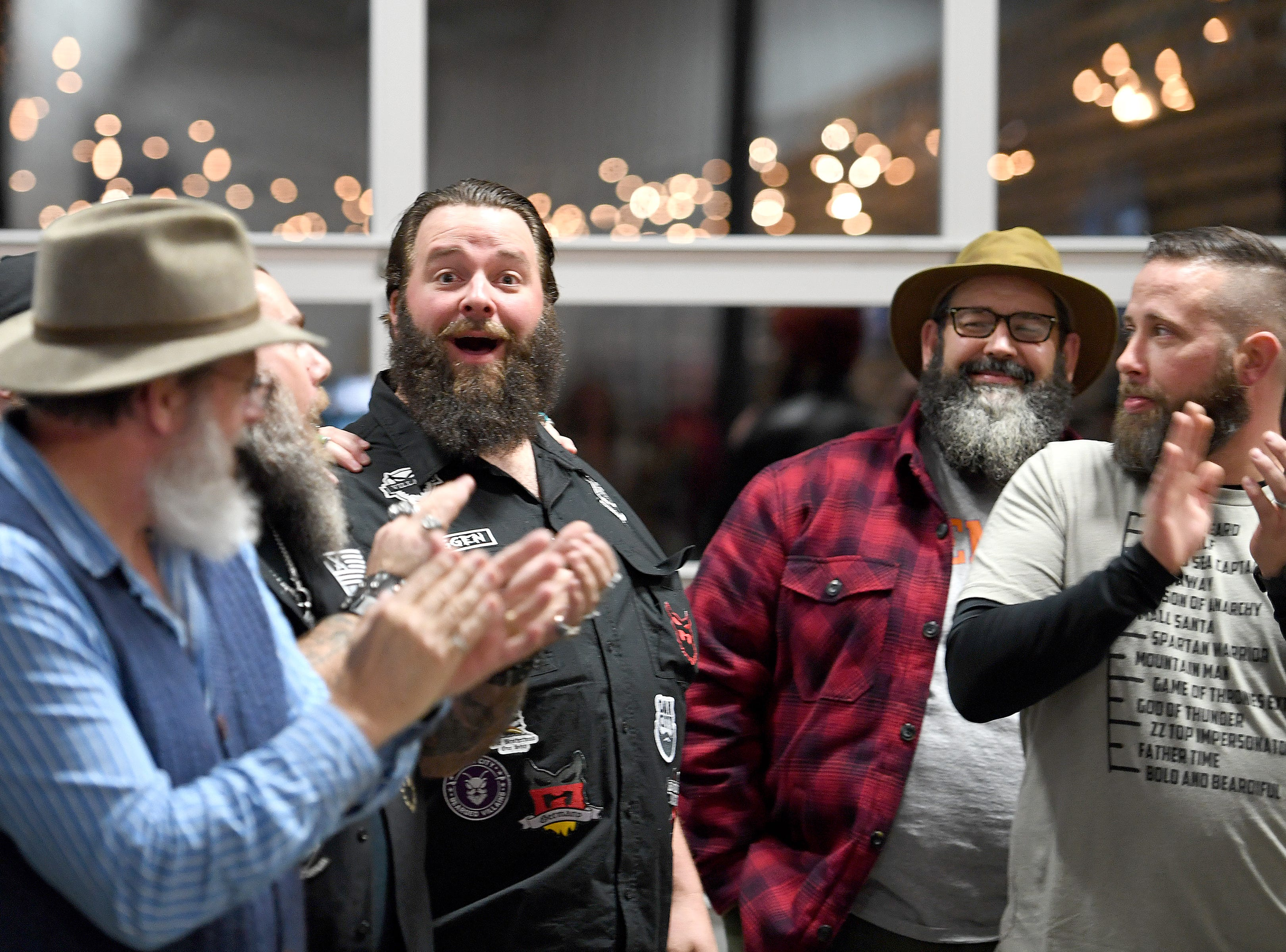 Adam Page reacts as he announced as the winner of baby beard category of the beard competition during Winter Beardfest at Bold Rock Hard Cider in Mills River on Jan. 12, 2019. Proceeds from the competition benefitted the Black Mountain Home Foster Care. Organizers are hoping to make the event annual.