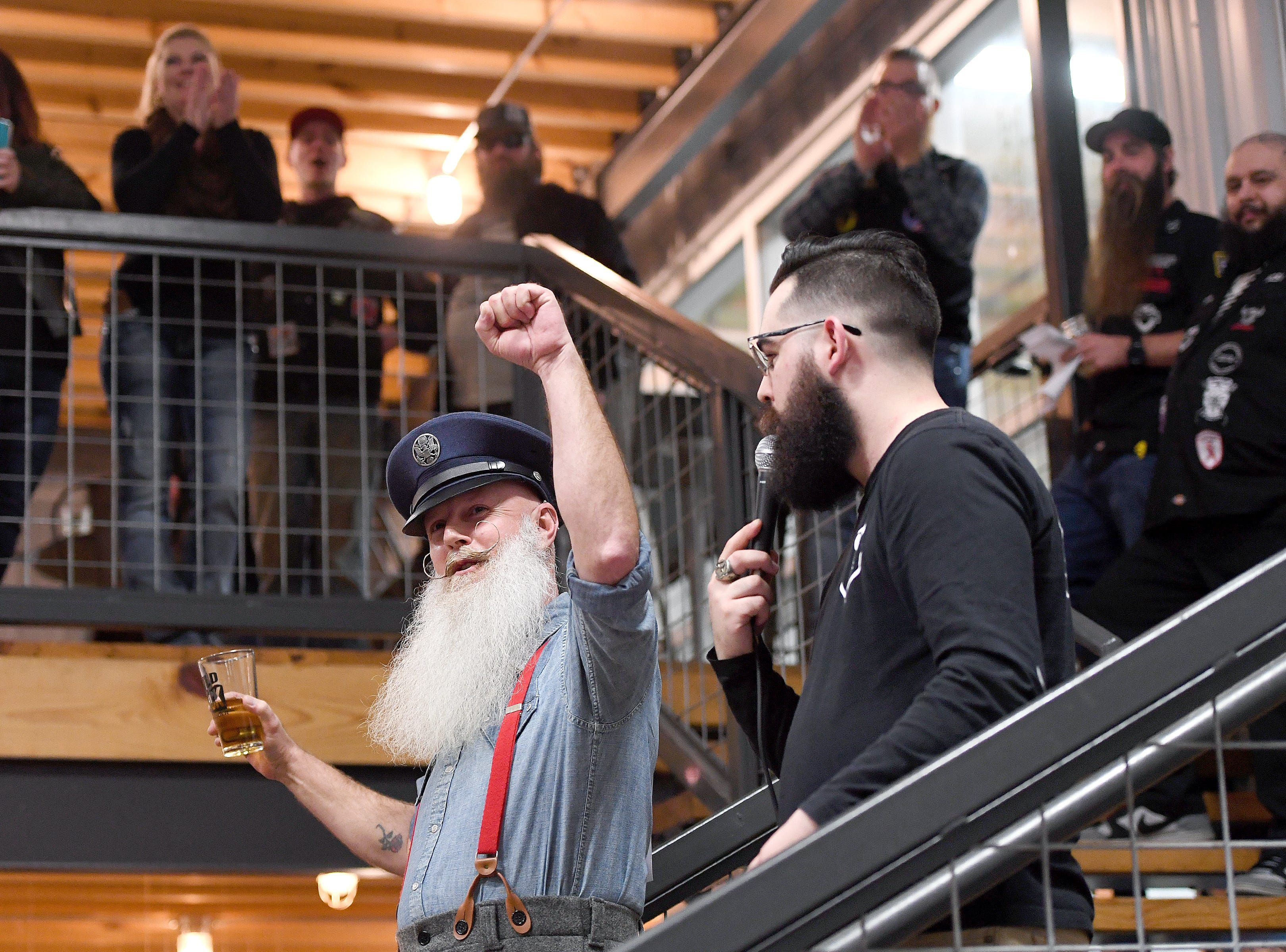 David Fender, also known as The Captain, is interviewed by Bearded Villains co-captain Chris Garcia, during the beard competition at Winter Beardfest at Bold Rock Hard Cider in Mills River on Jan. 12, 2019. Proceeds from the competition benefitted the Black Mountain Home Foster Care. Organizers are hoping to make the event annual.