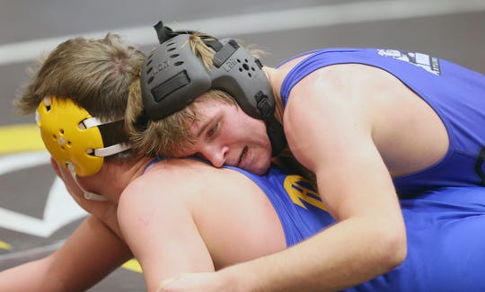 Daniel Pulley of North Mason battles with Josiah Sorensen of Bremerton in a 160 pound match at the CK Matman Wrestling Tournament at Central Kitsap High School on Saturday, January, 12, 2019.