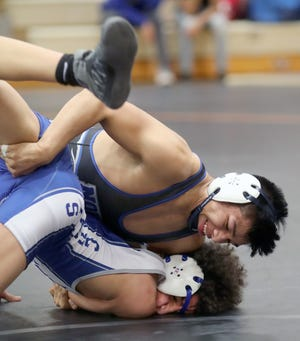 Thomas Francisco-Juan of North Mason smiles as he has opponent Terry Smith of Curtis in control in a 138 pound match at the CK Matman Wrestling Tournament at Central Kitsap High School on Saturday, January, 12, 2019.