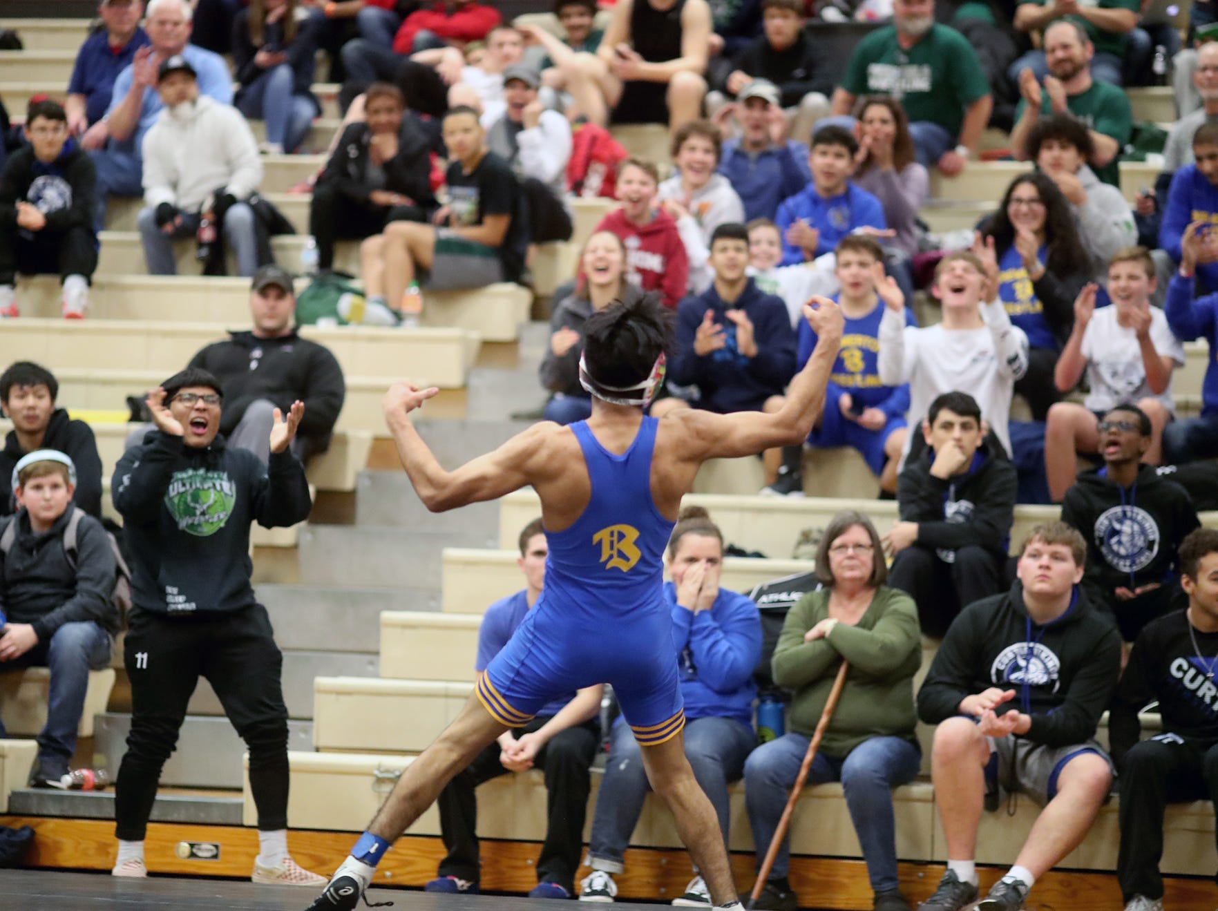 Estan Wakonabo of Bremerton plays the crowd after defeating Josia OÕ Bannon of Curtis in a 132 pound match  at the CK Matman Wrestling Tournament at Central Kitsap High School on Saturday, January, 12, 2019.