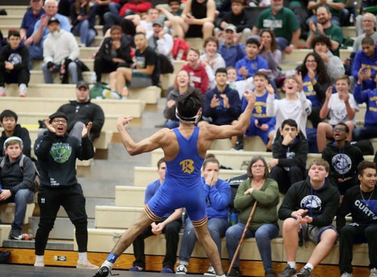 Estan Wakonabo of Bremerton plays the crowd after defeating Josia O'Bannon of Curtis in a 132 pound match at the CK Matman Wrestling Tournament at Central Kitsap High School on Saturday, January, 12, 2019.