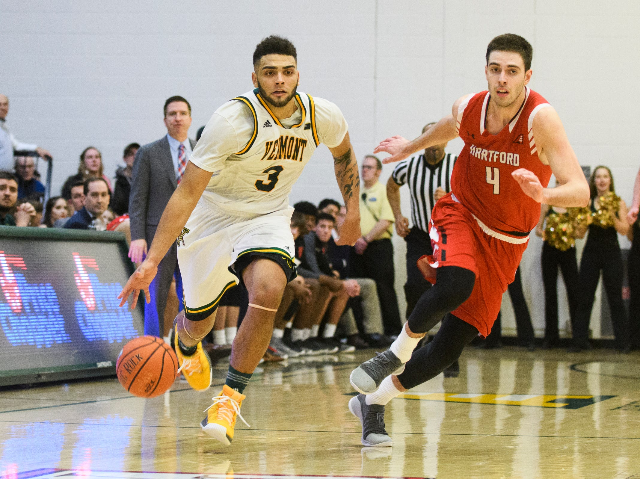 Vermont forward Anthony Lamb (3) dribbles the ball down the court past Hartford's George Blagojevic (4) during the men's basketball game between the Hartford Hawks and the Vermont Catamounts at Patrick Gym on Saturday night January 12, 2019 in Burlington.