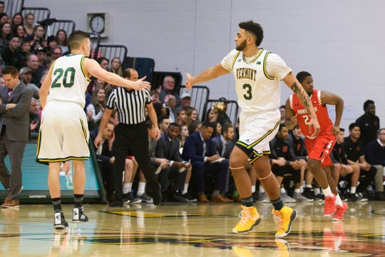 Vermont forward Anthony Lamb (3) high fives Vermont guard Ernie Duncan (20) during the men's basketball game between the Hartford Hawks and the Vermont Catamounts at Patrick Gym on Saturday night January 12, 2019 in Burlington.