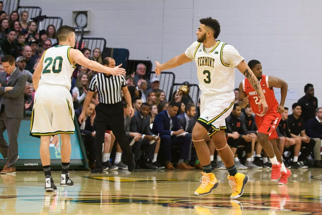 Vermont forward Anthony Lamb (3) high-fives guard Ernie Duncan (20) during a men's basketball game last month in Burlington.