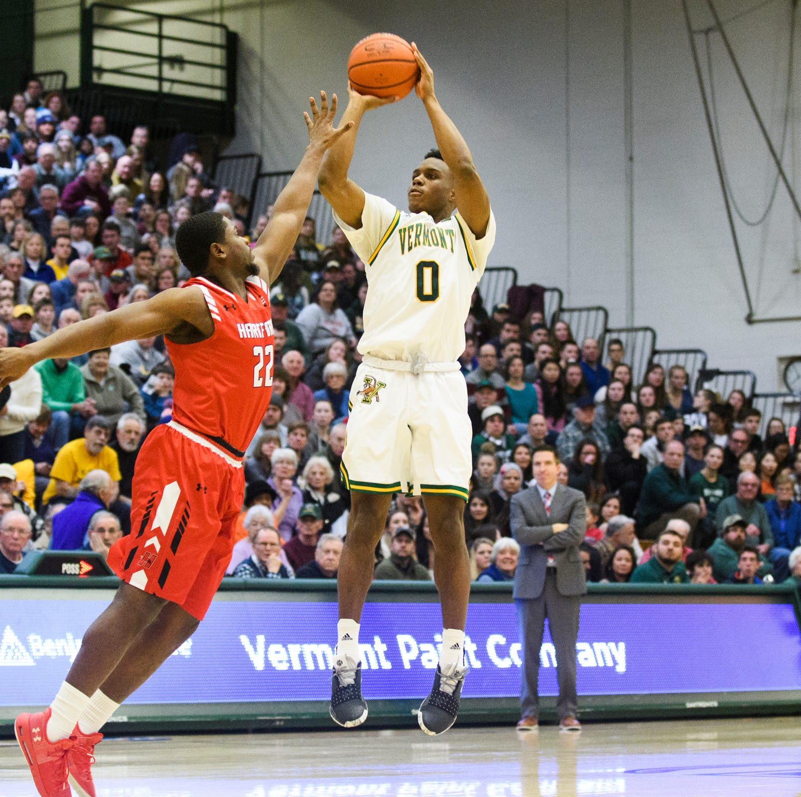 UVM men's basketball fends off feisty New Hampshire