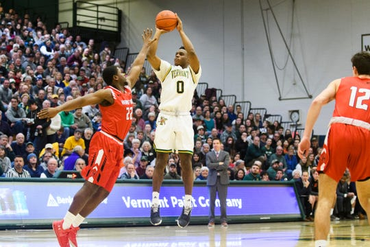 Vermont guard Stef Smith (0) shoots the ball  over Hartford's Travis Weatherington (22) during the men's basketball game between the Hartford Hawks and the Vermont Catamounts at Patrick Gym on Saturday night January 12, 2019 in Burlington.