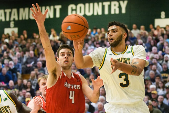 Vermont forward Anthony Lamb (3) passes the ball during the men's basketball game between the Hartford Hawks and the Vermont Catamounts at Patrick Gym on Saturday night January 12, 2019 in Burlington.