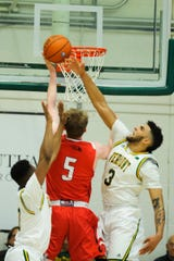 Vermont forward Anthony Lamb (3) leaps to block the shot by Hartford's John Carroll (5) during the men's basketball game between the Hartford Hawks and the Vermont Catamounts at Patrick Gym on Saturday night January 12, 2019 in Burlington.
