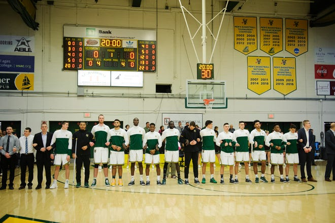 Vermont listens to the National Anthem during the men's basketball game between the Hartford Hawks and the Vermont Catamounts at Patrick Gym on Saturday night January 12, 2019 in Burlington.