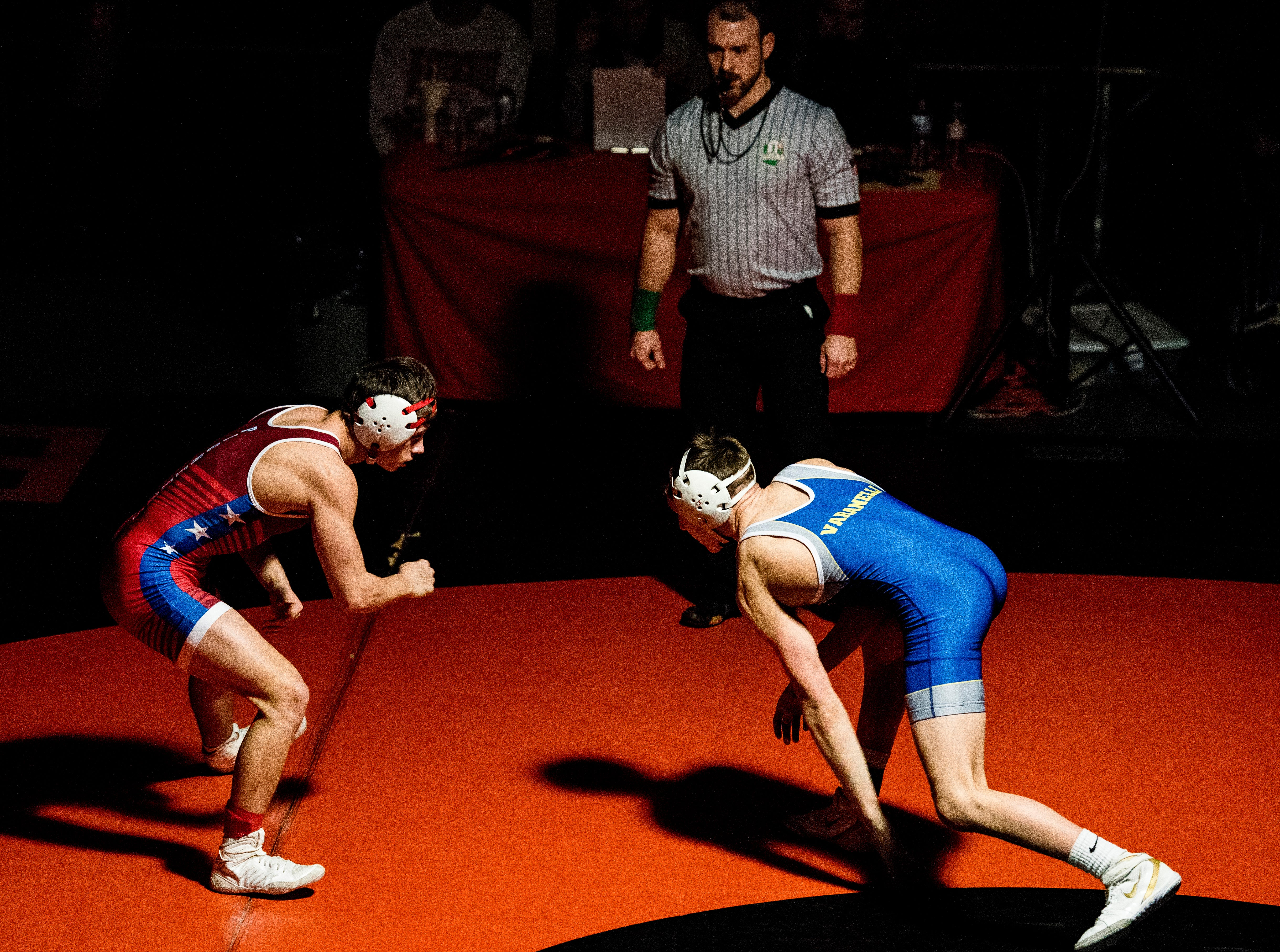 Zane Trace senior Jordan Hoselton wrestled under the Beavercreek championship spotlight Saturday at Beavercreek High School. Hoselton took second in the 132-pound weight class against Olentangy's Nick Varanelli.