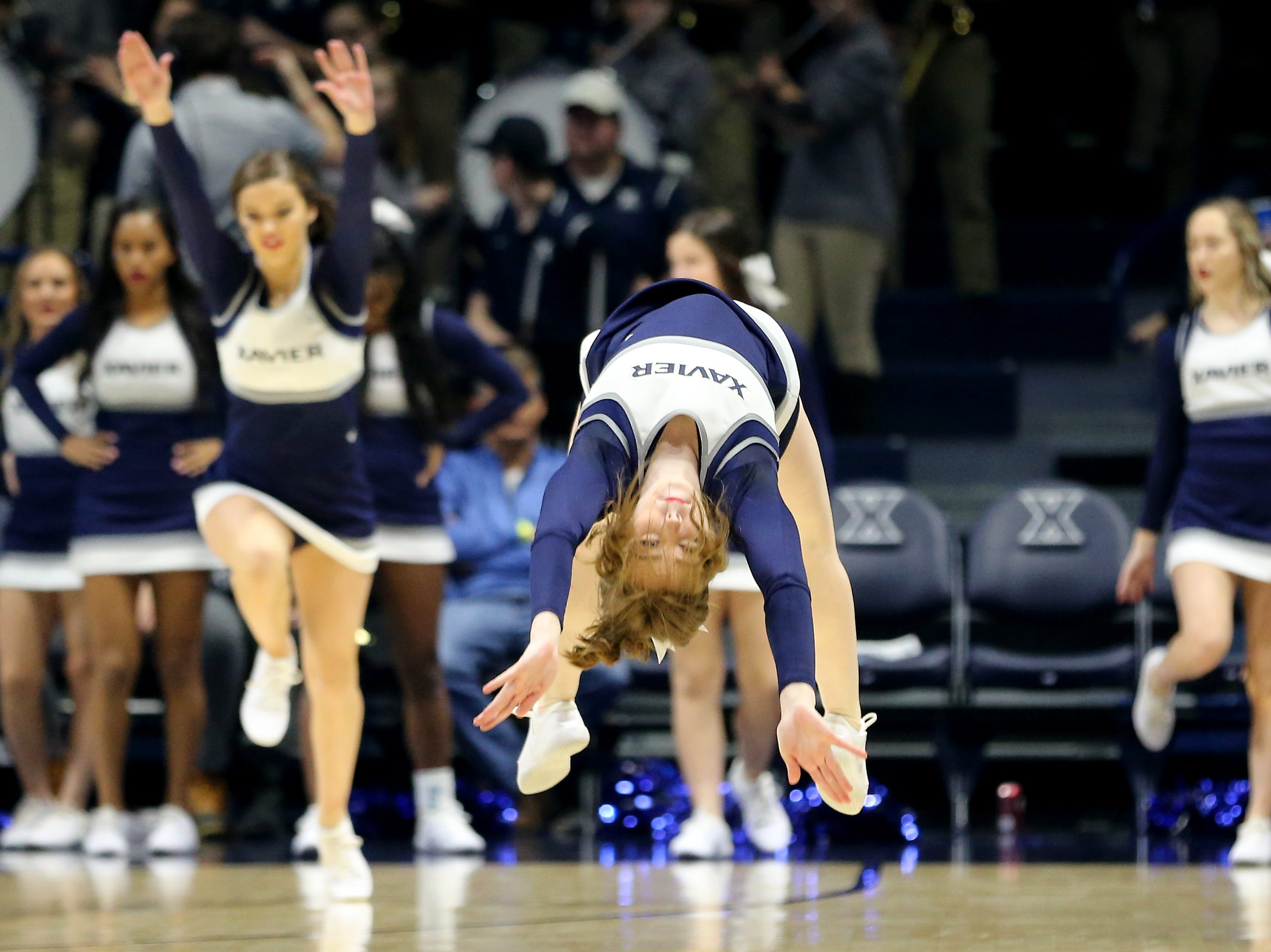 A Xavier Musketeers cheerleader performs during a timeout in the second half of an NCAA college basketball game against the Butler Bulldogs, Sunday, Jan. 13, 2019, at Cintas Center in Cincinnati. Xavier Musketeers won 70-69.