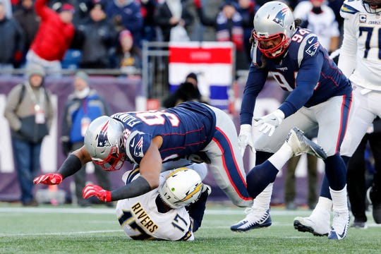 New England Patriots defensive end Trey Flowers (98) sacks Los Angeles Chargers quarterback Philip Rivers (17) during the third quarter in an AFC Divisional playoff football game at Gillette Stadium.