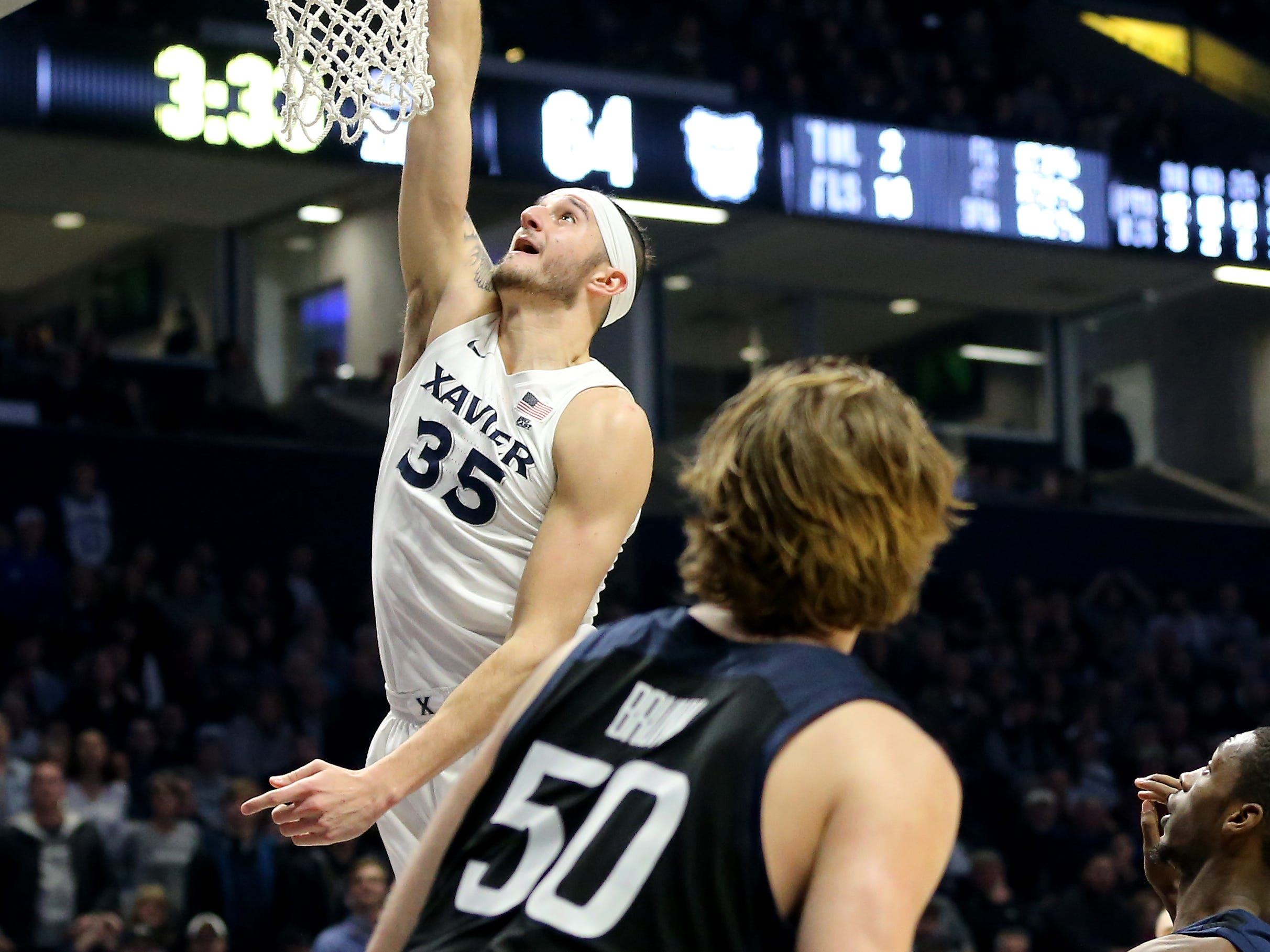 Xavier Musketeers forward Zach Hankins (35) scores a put-back basket in the second half of an NCAA college basketball game against the Butler Bulldogs, Sunday, Jan. 13, 2019, at Cintas Center in Cincinnati. Xavier Musketeers won 70-69.