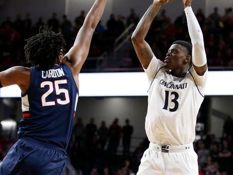 Cincinnati Bearcats forward Tre Scott (13) shoots over Connecticut Huskies forward Josh Carlton (25) during the second half of a basketball game Saturday, Jan. 12, 2019 in Cincinnati. Cincinnati won 74-72 in overtime. (Photo by Gary Landers for the Enquirer)