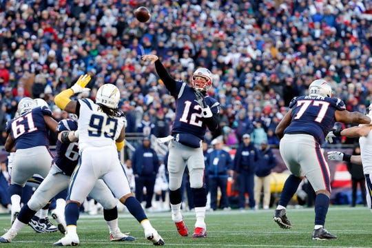 New England Patriots quarterback Tom Brady (12) throws the ball against the Los Angeles Chargers during the second quarter in an AFC Divisional playoff football game at Gillette Stadium.