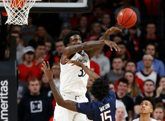Cincinnati Bearcats center Nysier Brooks (33) blocks a shot by Connecticut Huskies guard Sidney Wilson (15) during the first half of a basketball game Saturday, Jan. 12, 2019 in Cincinnati. (Photo by Gary Landers for the Enquirer)