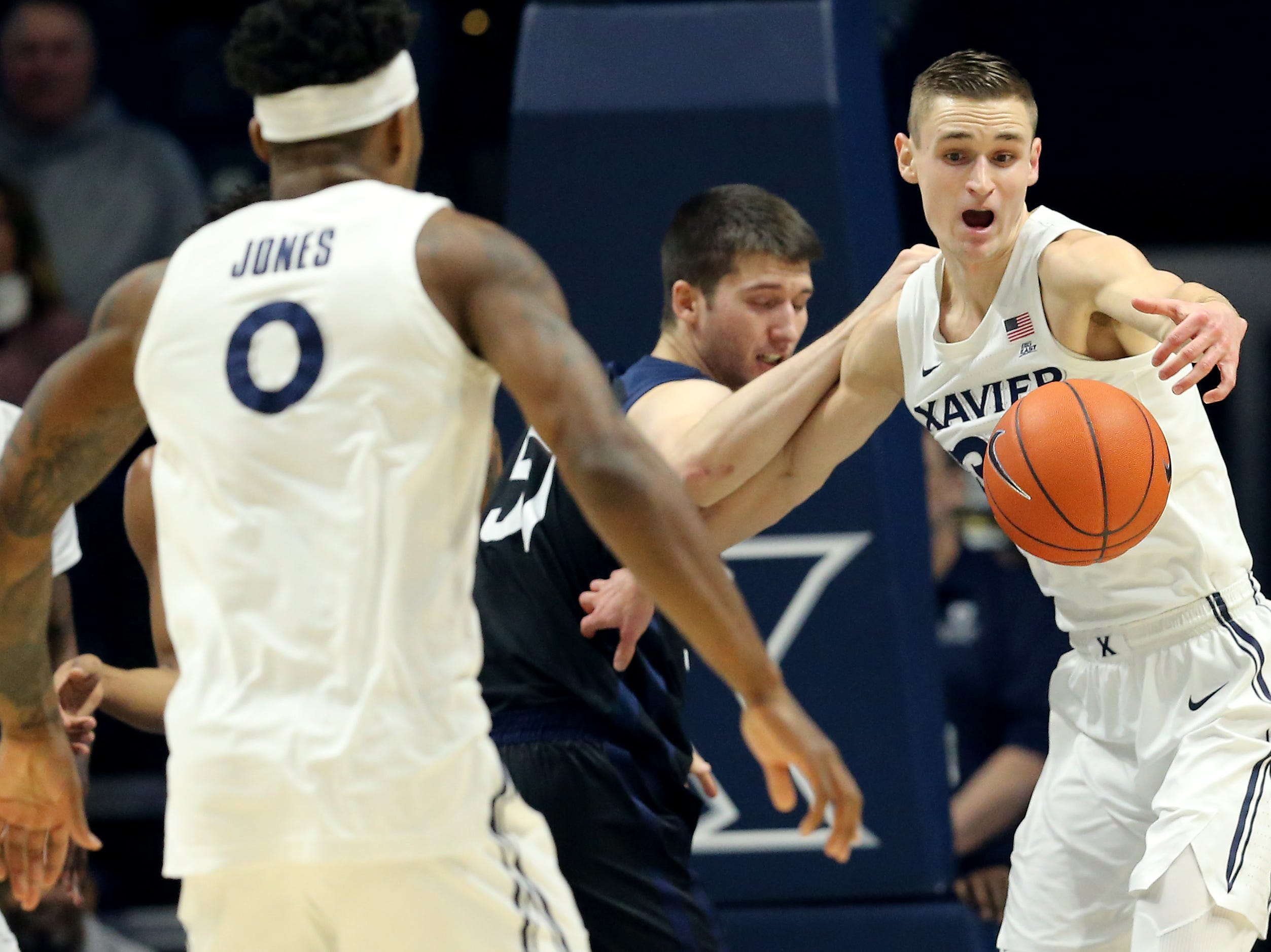 Xavier Musketeers forward Ryan Welage (32) eyes a loose ball in the first half of an NCAA college basketball game against the Butler Bulldogs, Sunday, Jan. 13, 2019, at Cintas Center in Cincinnati.