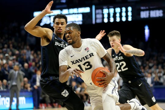 Xavier Musketeers forward Naji Marshall (13) drives to the basket in the second half of an NCAA college basketball game against the Butler Bulldogs, Sunday, Jan. 13, 2019, at Cintas Center in Cincinnati. Xavier Musketeers won 70-69.