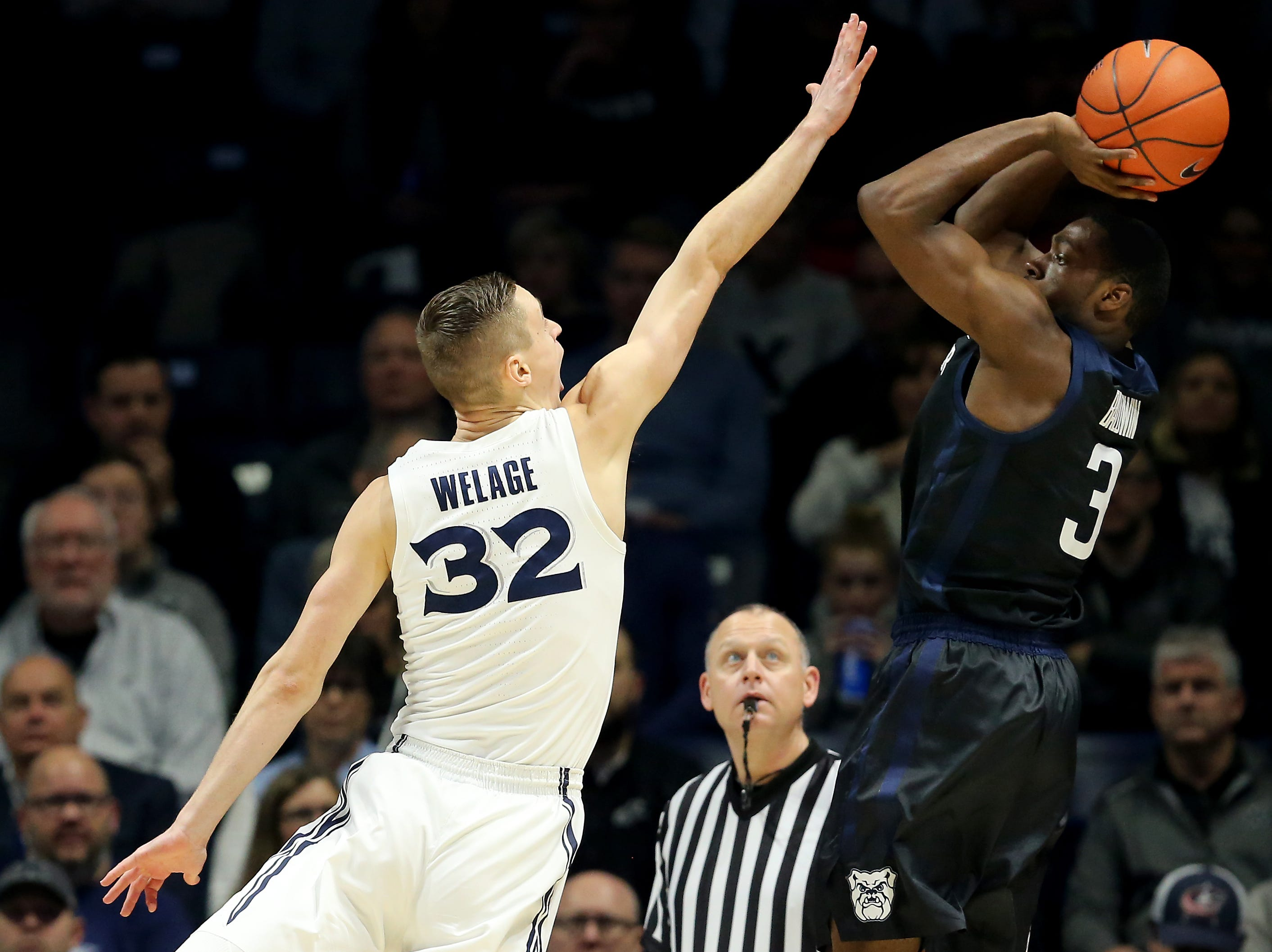 Butler Bulldogs guard Kamar Baldwin (3) rises for a shot as Xavier Musketeers forward Ryan Welage (32) defends in the first half of an NCAA college basketball game, Sunday, Jan. 13, 2019, at Cintas Center in Cincinnati.