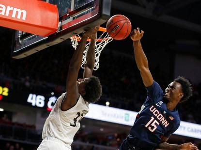 Connecticut Huskies guard Sidney Wilson (15) blocks a shot by Cincinnati Bearcats center Nysier Brooks (33) during the second half of a basketball game Saturday, Jan. 12, 2019 in Cincinnati. Cincinnati won 74-72 in overtime. (Photo by Gary Landers for the Enquirer)