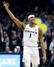 Xavier Musketeers guard Paul Scruggs (1) celebrates a made 3-point basket in the second half of an NCAA college basketball game against the Butler Bulldogs, Sunday, Jan. 13, 2019, at Cintas Center in Cincinnati. Xavier Musketeers won 70-69.