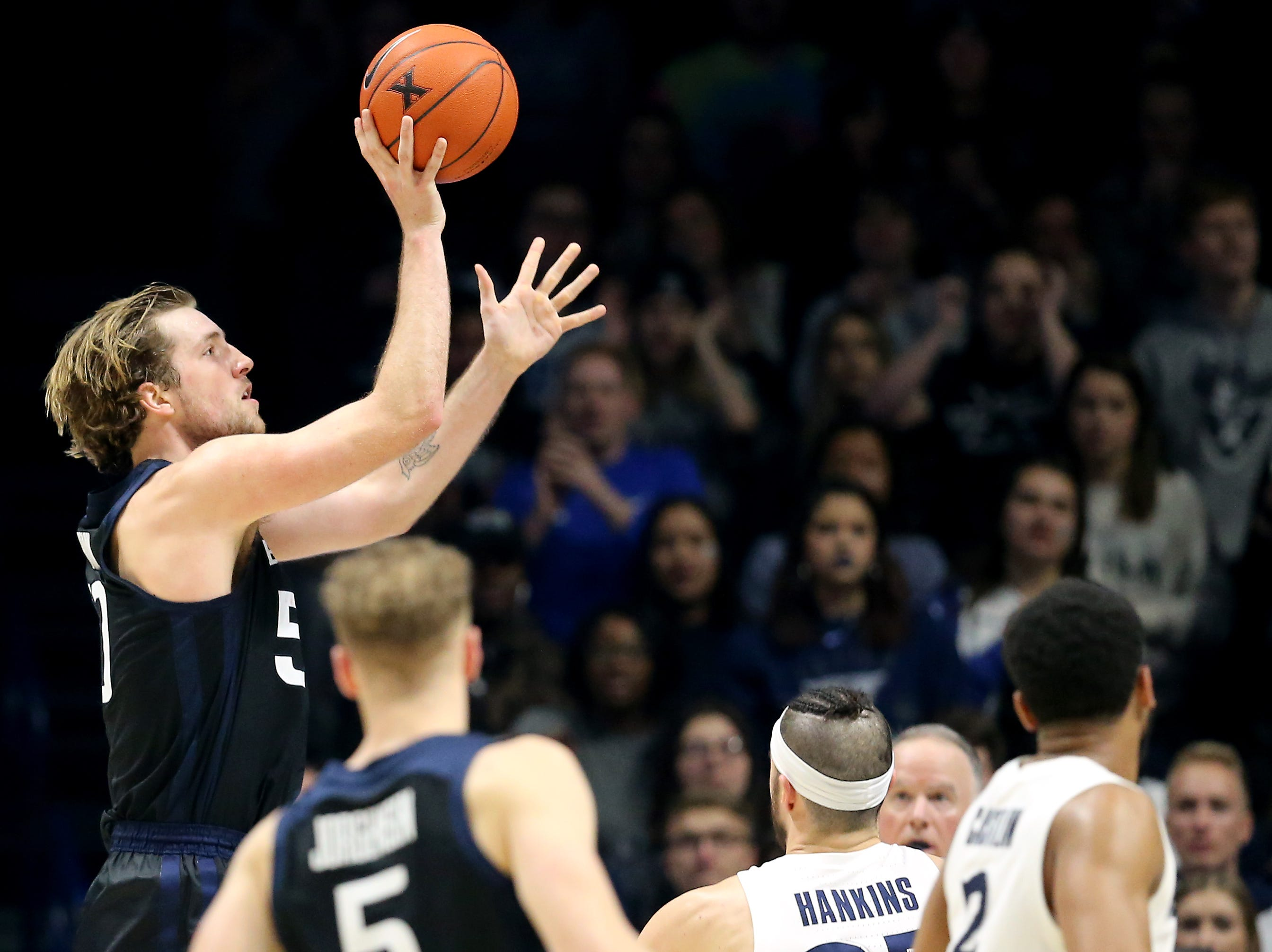 Butler Bulldogs forward Joey Brunk (50) rises for a shot over Xavier Musketeers forward Zach Hankins (35) in the second half of an NCAA college basketball game, Sunday, Jan. 13, 2019, at Cintas Center in Cincinnati. Xavier Musketeers won 70-69.