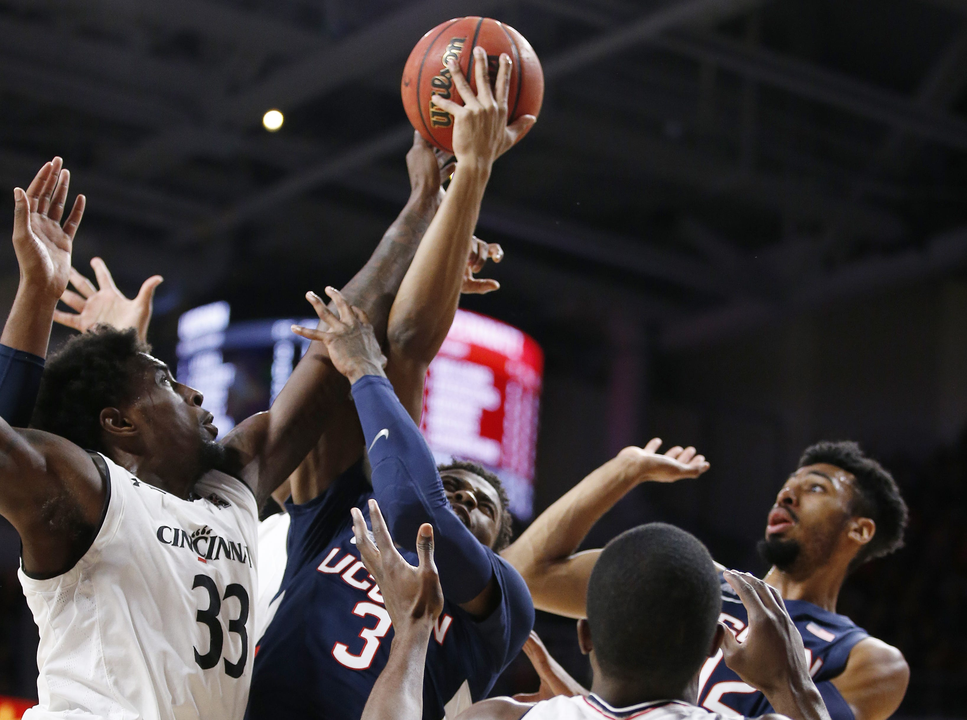 Cincinnati Bearcats center Nysier Brooks (33) fights for a rebound against Connecticut Huskies guard Alterique Gilbert (3) during the first half of a basketball game Saturday, Jan. 12, 2019 in Cincinnati. (Photo by Gary Landers for the Enquirer)