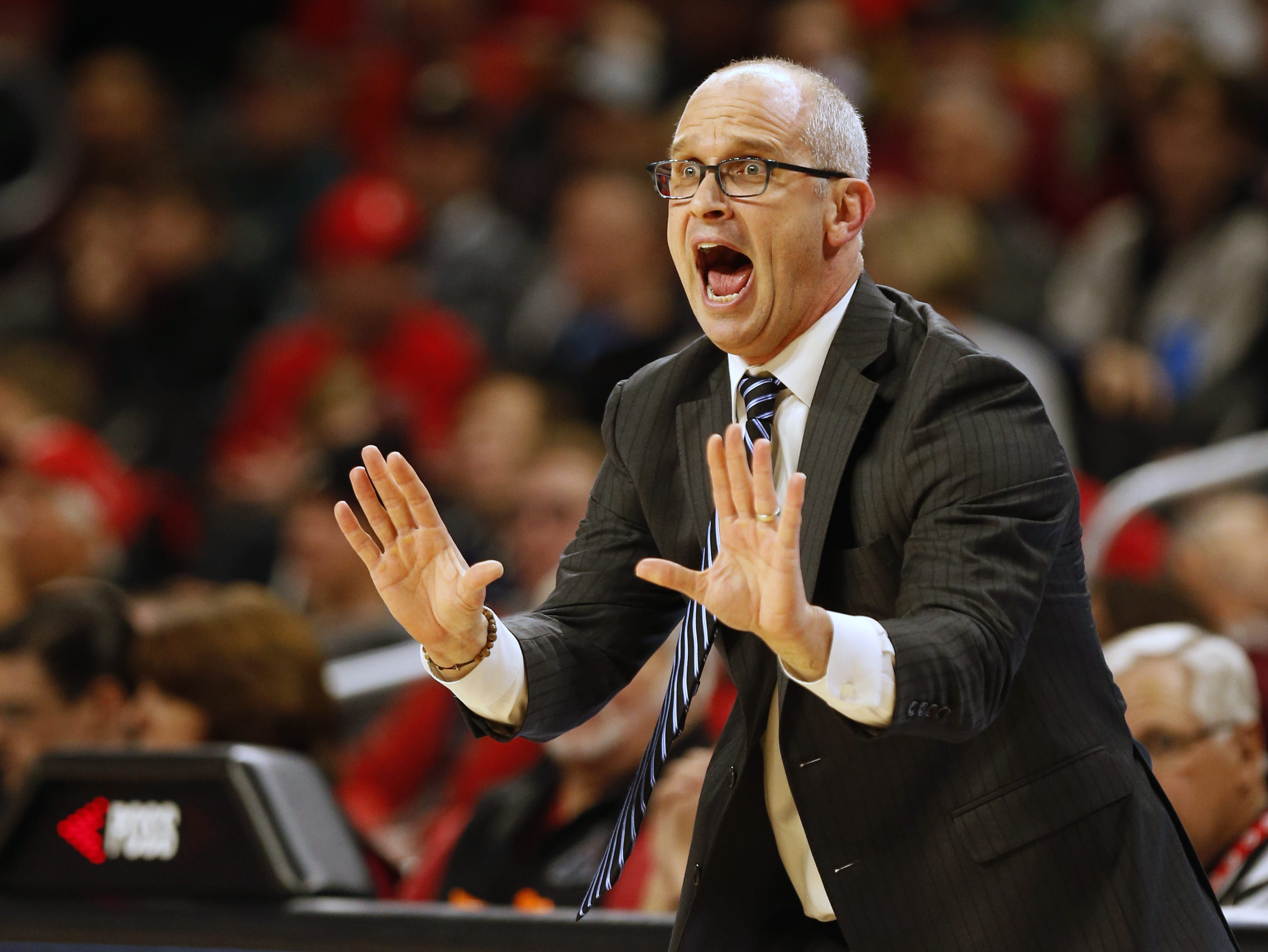 Connecticut Huskies head coach Dan Hurley gives instructions to his team against Cincinnati during the first half of a basketball game Saturday, Jan. 12, 2019 in Cincinnati. (Photo by Gary Landers for the Enquirer)