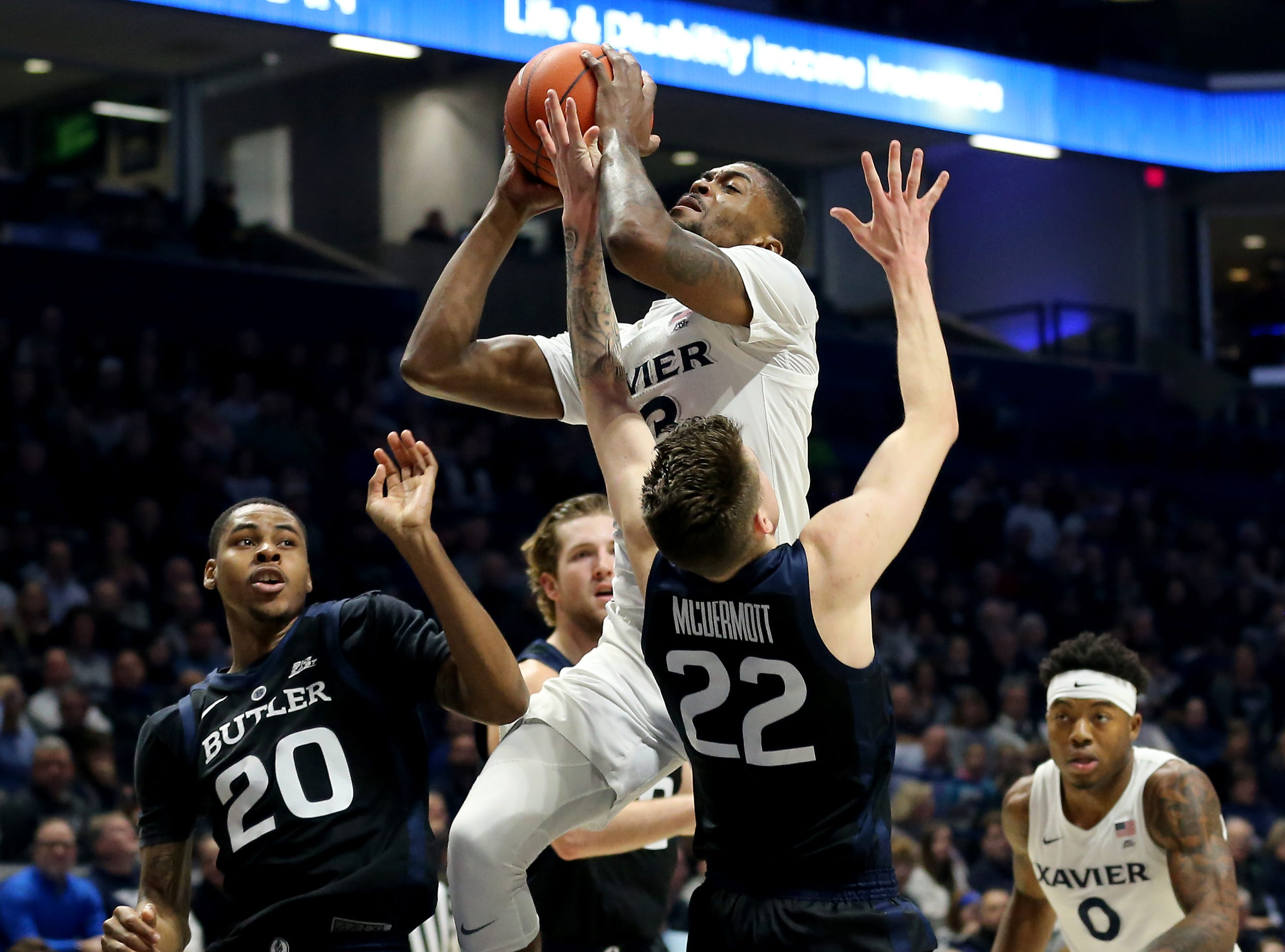 Xavier Musketeers forward Naji Marshall (13) goes up for a shot as Butler Bulldogs forward Sean McDermott (22) defends in the first half of an NCAA college basketball game, Sunday, Jan. 13, 2019, at Cintas Center in Cincinnati.