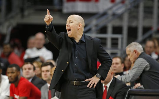 Cincinnati Bearcats head coach Mick Cronin gives instructions to his team against Connecticut during the first half of a basketball game Saturday, Jan. 12, 2019 in Cincinnati. (Photo by Gary Landers for the Enquirer)