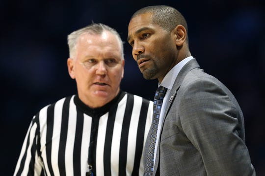 Butler Bulldogs head coach LaVall Jordan listens to an explantation from an official in the first half of an NCAA college basketball game against the Xavier Musketeers, Sunday, Jan. 13, 2019, at Cintas Center in Cincinnati.