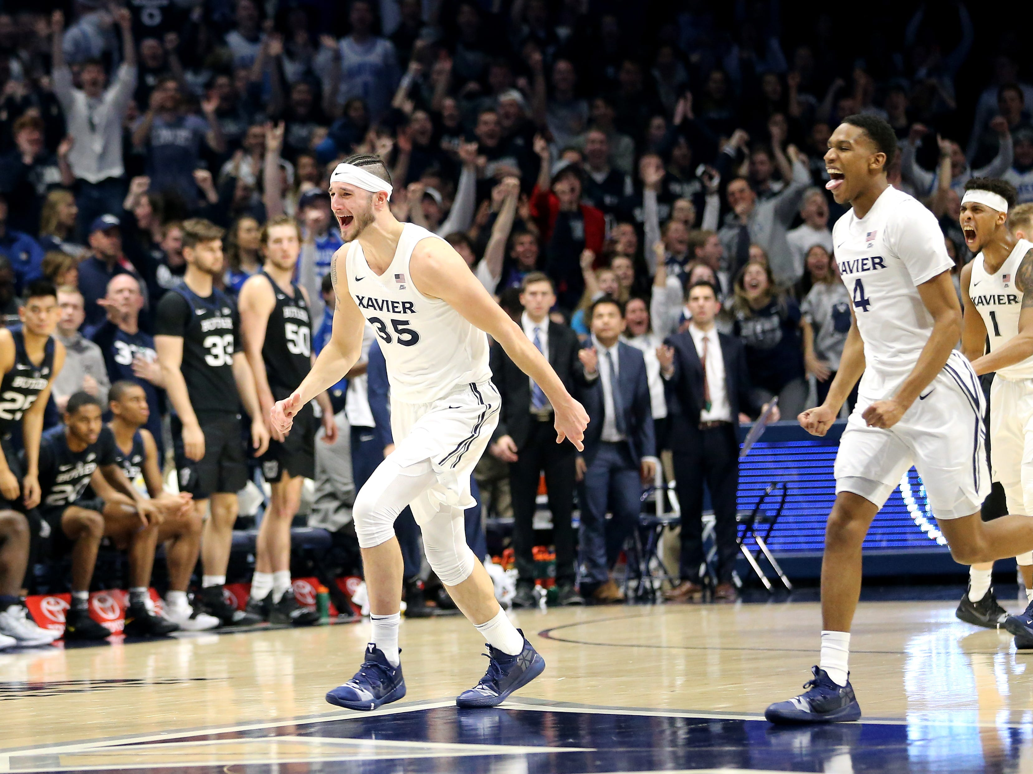 Xavier Musketeers forward Zach Hankins (35), Xavier Musketeers guard Elias Harden (4) and Xavier Musketeers guard Paul Scruggs (1) celebrate the win in the second half of an NCAA college basketball game, Sunday, Jan. 13, 2019, at Cintas Center in Cincinnati. Xavier Musketeers won 70-69.